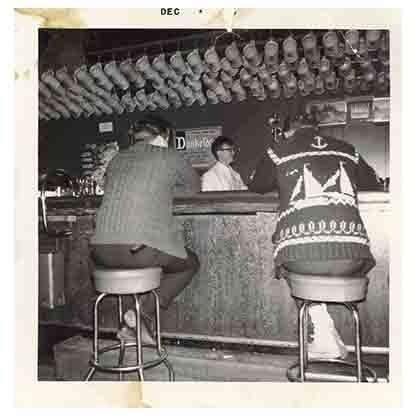 Erich behind bar '60s
